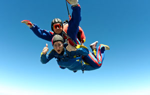 Skydiving is a thrilling auction item idea.