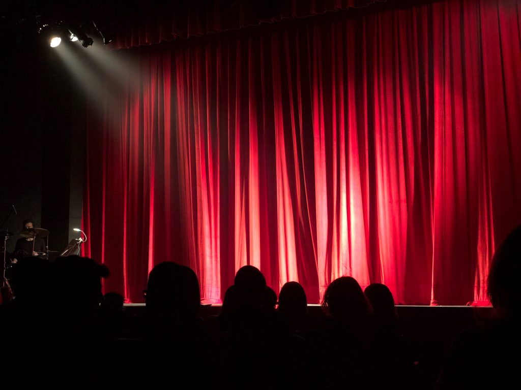 Closed curtain on stage with spotlight