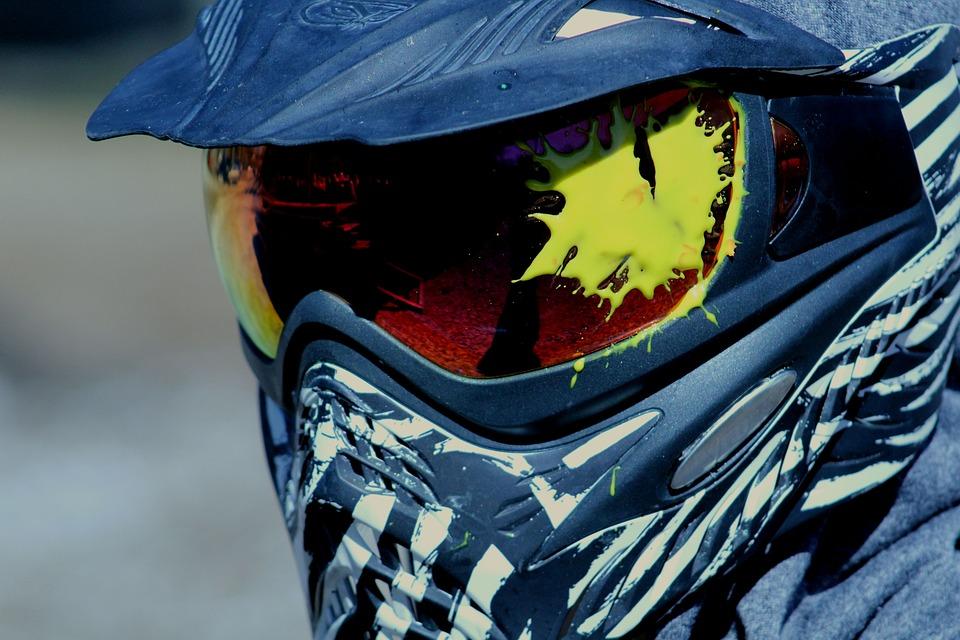 Yellow paintball impacts on paintball helmet.