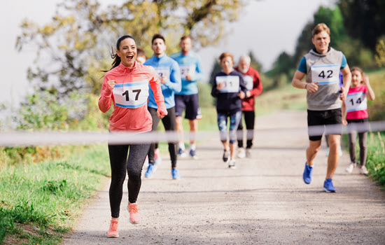 Venue management for in-person events entails creating an excellent guest experience. Guests are enjoying this 5K race because the event was well-planned.