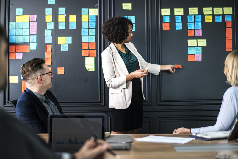 Woman planning a major gifts strategy with colorful post-it notes