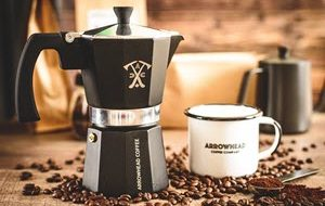 Picture of coffee mug and pour over coffee pot from a coffee subscription service