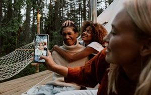 Friends taking a photo while camping