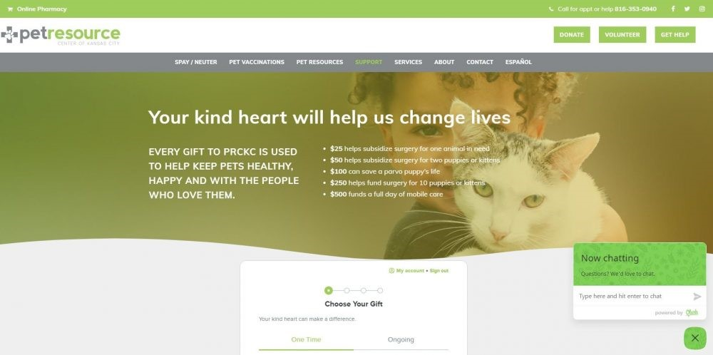 Image from Pet Resource Center's donation page showing a child holding a cat. Both are making eye contact with the camera, which is a photo best practice for nonprofits.